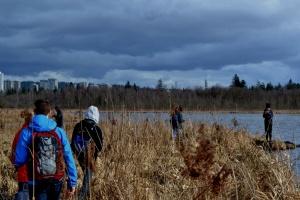 Workshop participants map the contour of a marsh along Burnaby Lake Marsh (Photo: Rachel Schott)