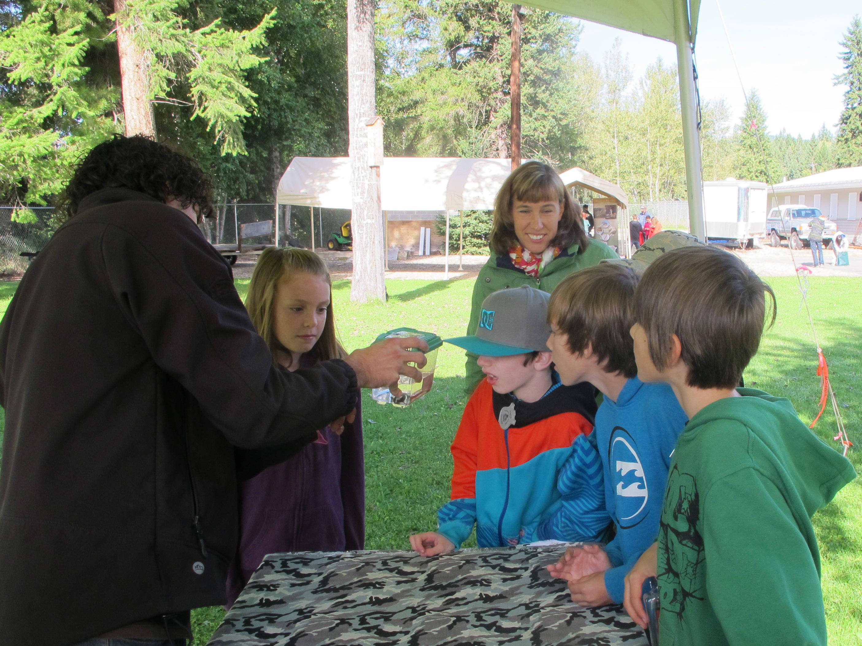 Jason teaching students about aquatic invertebrates.