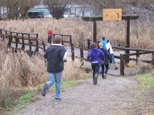 In teams, students race around their school to complete gps challenge race