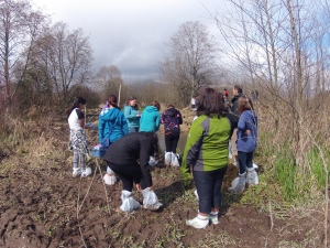 School children strap on thier makeshift boots to learn in the brand new wetland