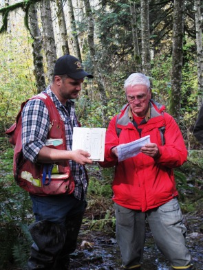 Biologist Ryan Durand walks a participant through a wetland classification form