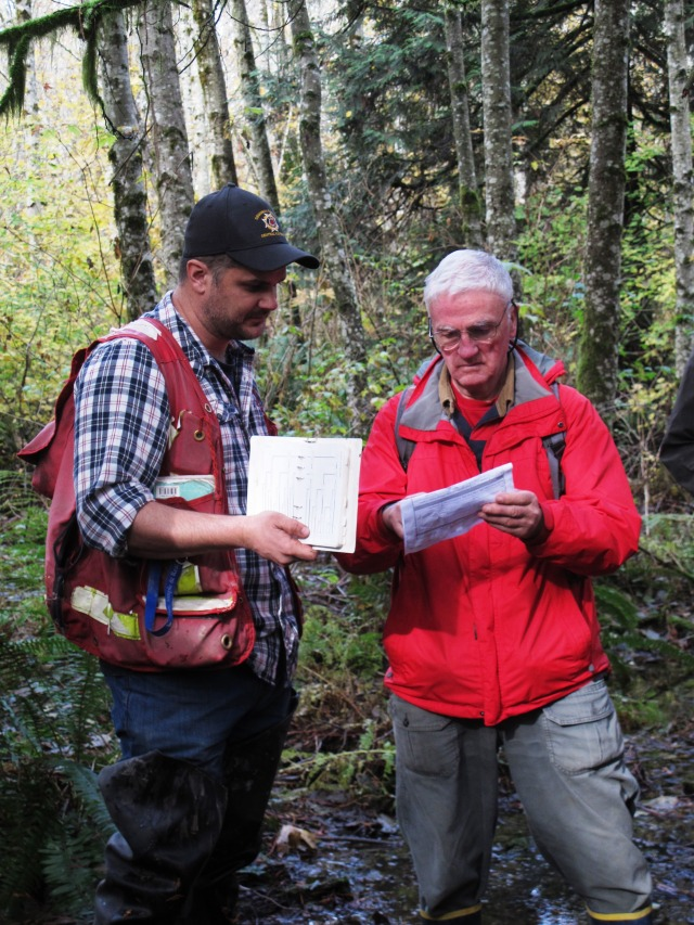 Biologist Ryan Durand walks a participant through a wetland classification form